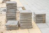 Stack of cement floor tiles at road side construction site — Stock Photo