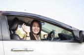 Asian car driver woman smiling showing new car keys — Foto Stock