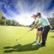 Young sportive couple playing golf on a golf course — Stock Photo #58026423