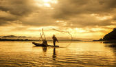 Fisherman of Lake in action when fishing — Stock Photo