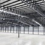 Large modern empty storehouse — Stock Photo #65954587