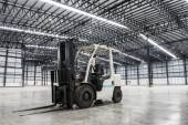 Forklift loader in large modern storehouse — Stok fotoğraf