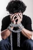 Drugs Man fists in strained chains — Stock Photo