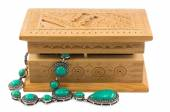 Turquoise beads in a wooden box isolated on white background — Stock Photo