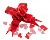 Red ribbon and confetti in the form of hearts isolated on white  — Foto Stock