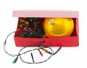 Electric Garland and ball in box isolated on white background — Stock Photo