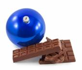 Chocolate and Christmas ball isolated on a white background — Stock Photo