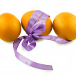 Three eggs and a purple ribbon isolated on white background — Stock Photo #65002363