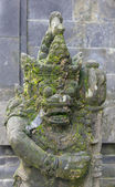 Ancient stone sculpture near the temple, Bali — Stock Photo