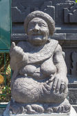 Stone sculpture representing the old woman — Stock Photo