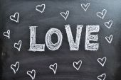 The word Love and hearts on a blackboard, background — Foto Stock