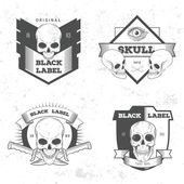 Set of skull logotypes — Stock Vector