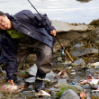 Asian fisherman caught salmon in Seward — Stok fotoğraf #56529375