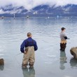 Two men staning in ocean and fishing in Seward — Stok fotoğraf #56529533