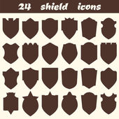 24 shield icons. Set of different shield shapes icons, borders,  — Stock Vector