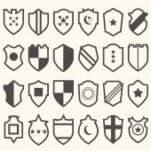 Set of shield icons with symbols — Stock Vector