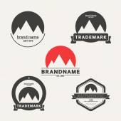 Vector set of emblems associated with mountains — Stock Vector