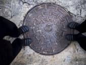 Aged drain made of iron on concrete  — Stock Photo