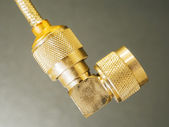 Brass N-type connector in head of coaxial — Stock Photo