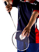 Hand of player with racket and shuttlecock — Stock Photo