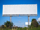 Blank billboard on blue sky, for fill text — Stock Photo