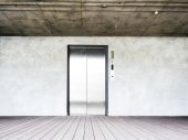 Elevator on wooden floor and concrete wall — Foto de Stock