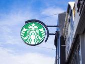 Starbuck logo on blue sky background — Stock Photo