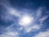Lens flare on blue sky — Stock Photo