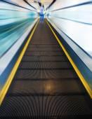 The escalator leading forward to next floor — Stock Photo