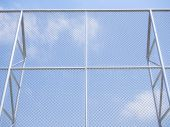 High steel fence installed against blue sky — Stock Photo