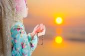 Young muslim woman praying for Allah — Stock Photo