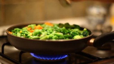 Frosted vegetables on natural blue gas — Stock Video