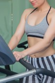 Girl on treadmill — Stock Photo