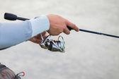 Fisherman holding spinning — Stockfoto