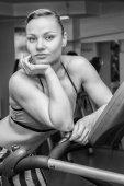 Girl on treadmill — Stock Photo