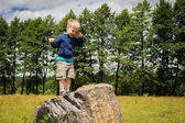 Boy and stone — Stock Photo