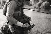 Fisherman on the river bank. — Foto de Stock