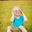 Young boy wearing sunglasses. — Stock Photo #53607387