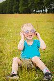 Young boy wearing sunglasses. — Stock Photo