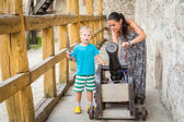 Mom and son near the cannon. — Stock Photo