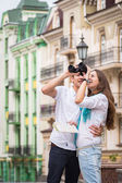 Girl and guy on the streets of European cities. — Stock Photo