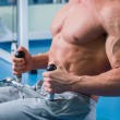 Muscular man working out with weights — Stock Photo #54990307