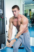 Muscular man working out with weights — Stock Photo