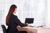 Business woman with notebook in the office — Stock Photo