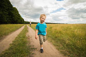 Boy running in nature — Stock Photo