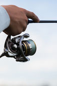 Fisherman with a fishing rod — Stock Photo