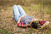 Brunette woman in casual clothes on nature — Stock Photo