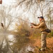 Fisherman  with spinning on the river bank — Stock Photo #58921987