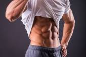 Man shows his abdominal muscles — Stock Photo