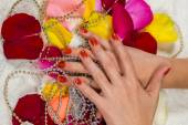 Manicured hands with red nail polish — Stock Photo